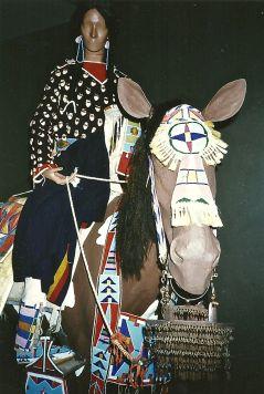 Cheyenne woman on horse